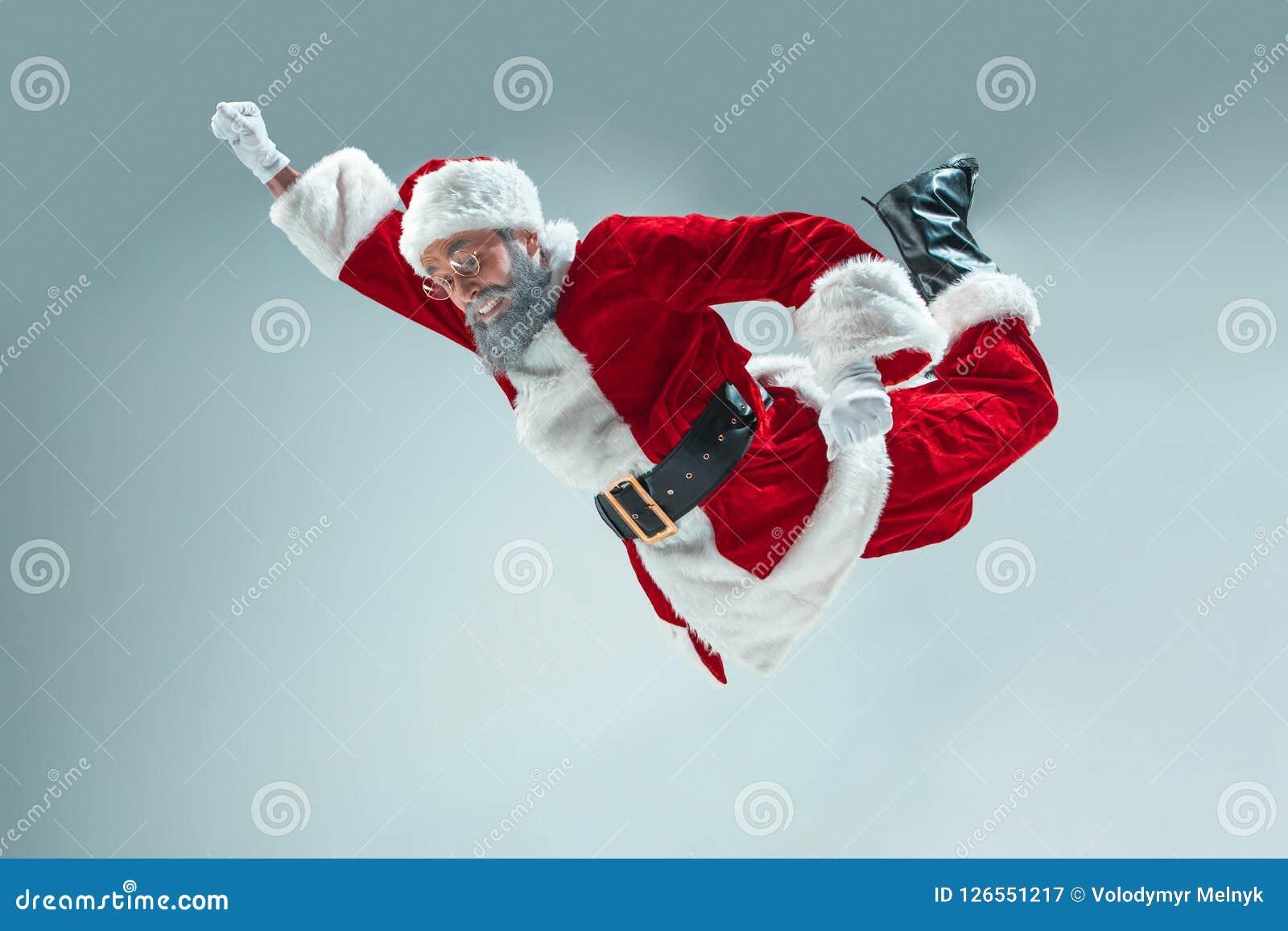 Indivíduo engraçado no chapéu do Natal Feriado do ano novo Natal, x-mas, inverno, conceito dos presentes