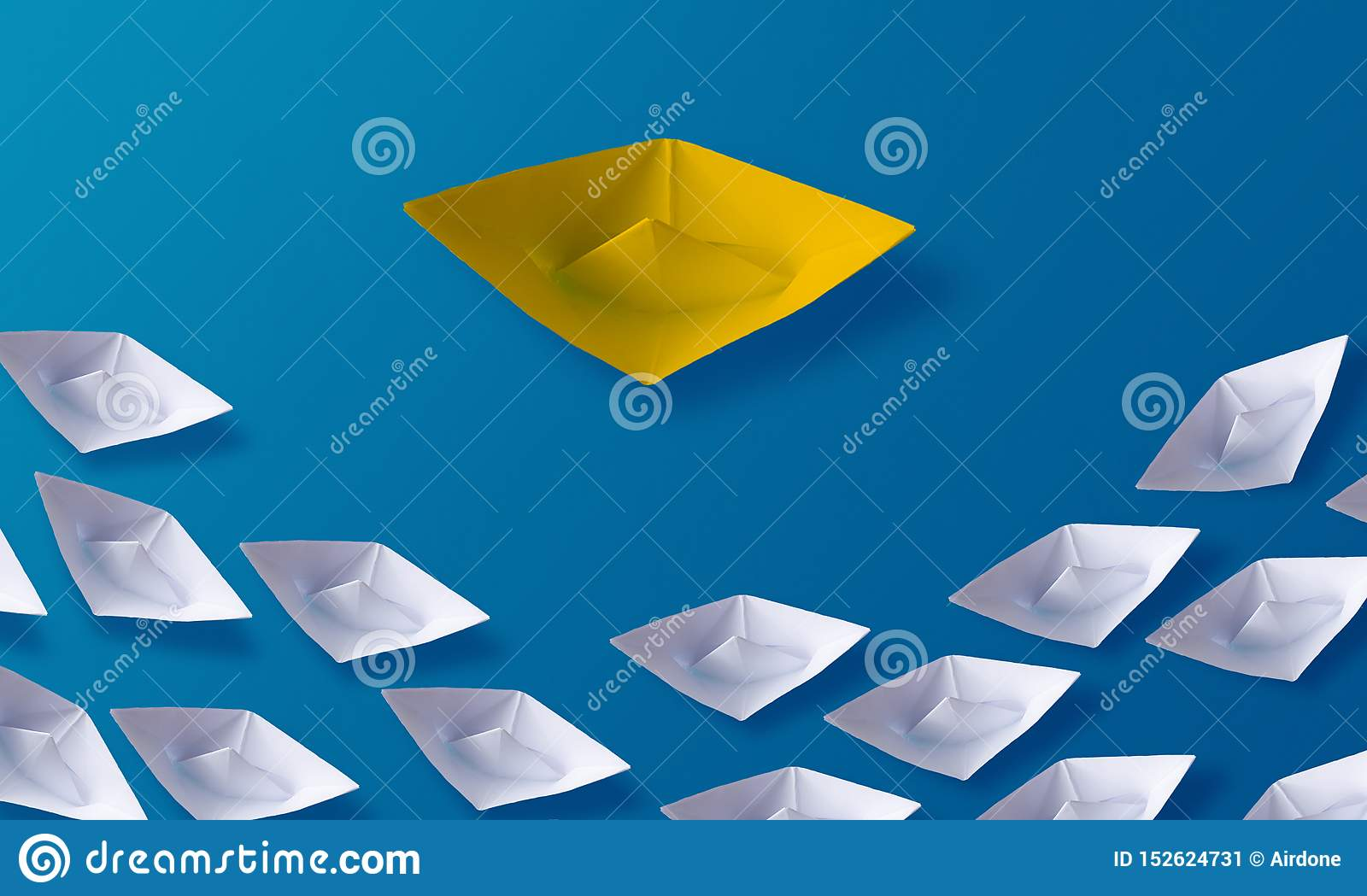 Individuality Be Different Concept, Yellow Origami Paper Boat and White Boats