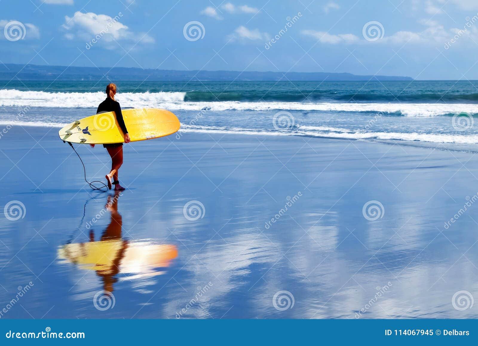 Indonesia, Bali Island, Kuta - October 10, 2017: Girl Surfer