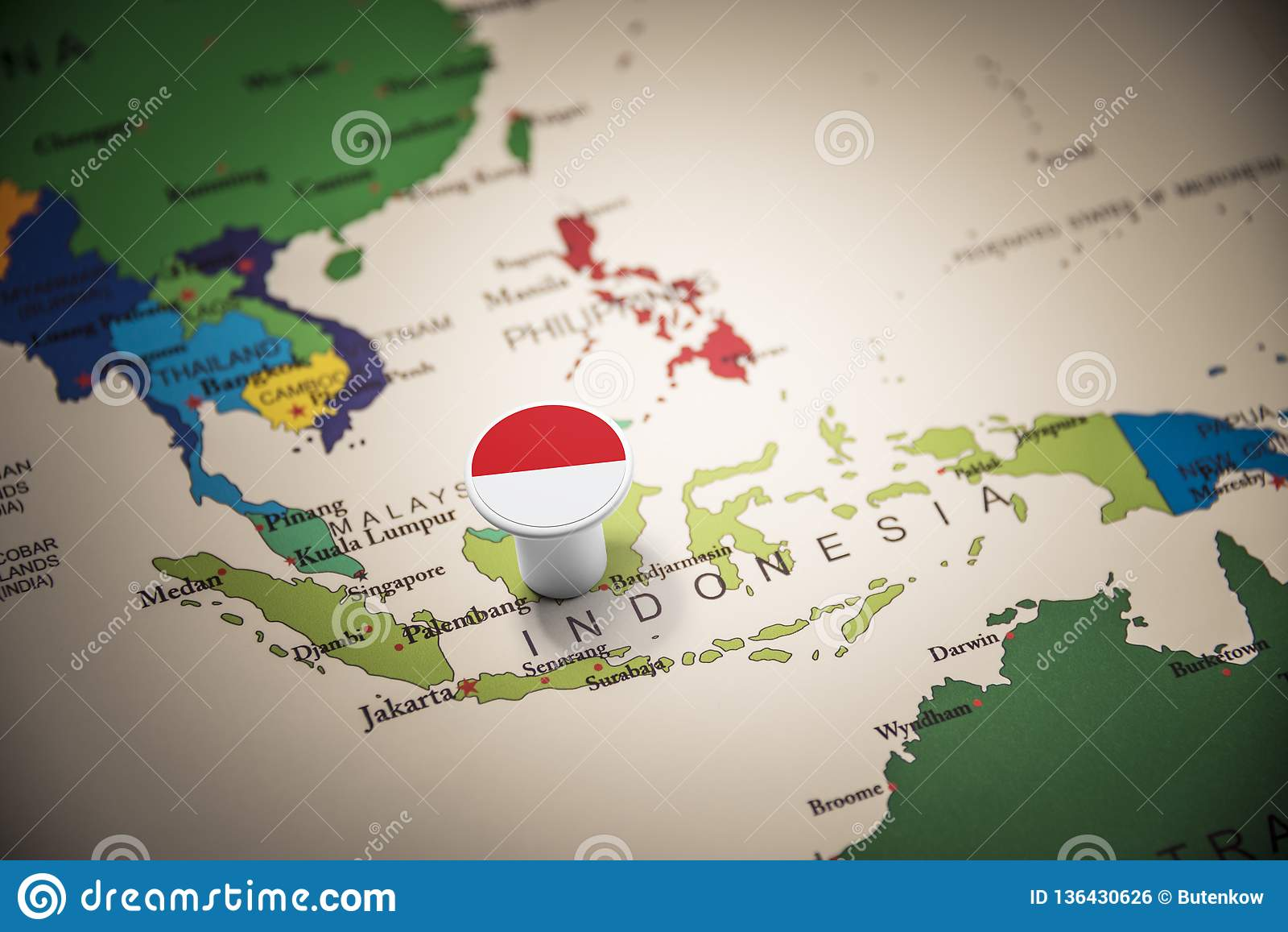 Indonesia marked with a flag on the map
