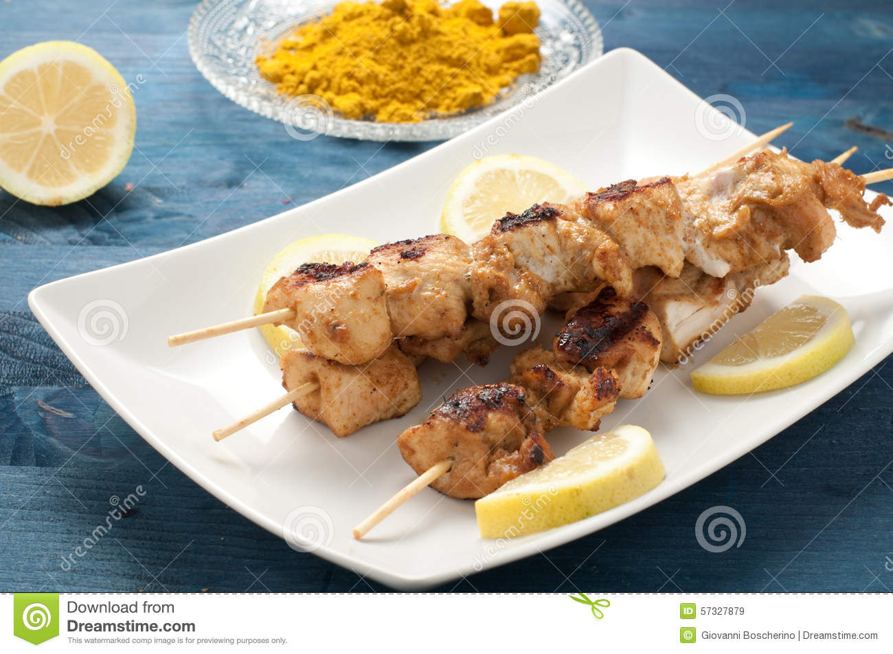 ... Photo: Indonesian chicken satay skewers with curry , peanut butter