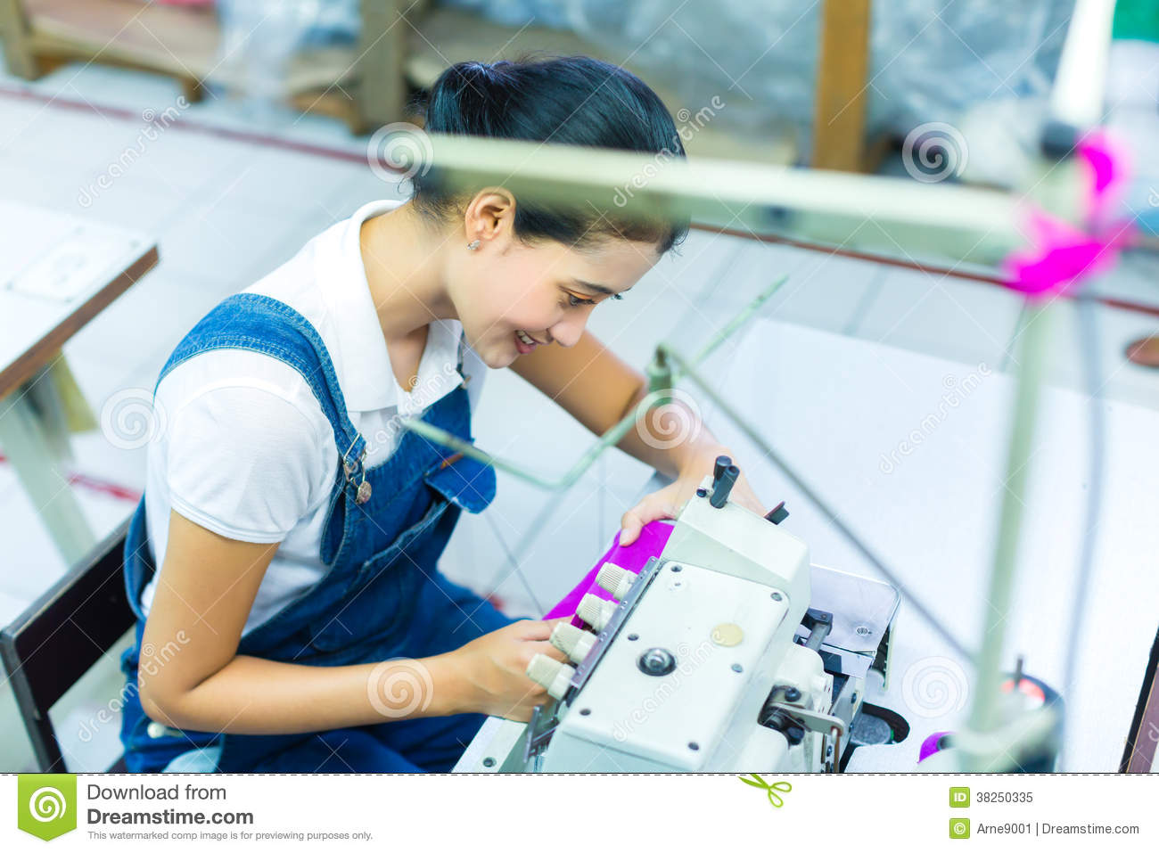 Indonesian seamstress in a textile factory