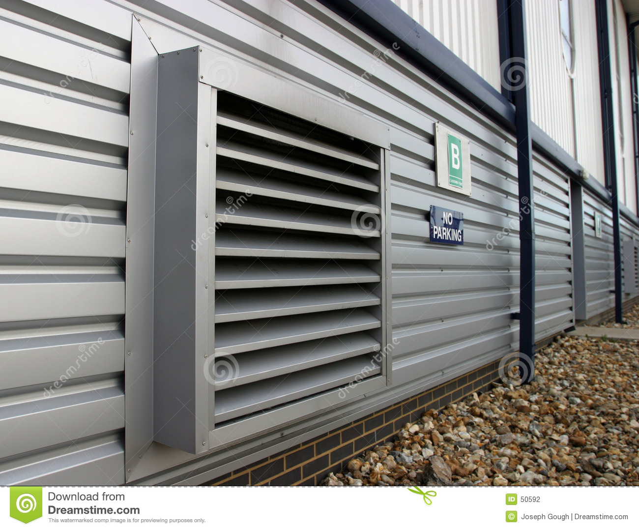 Air ventilation detail on the side of a modern factory. #604A34