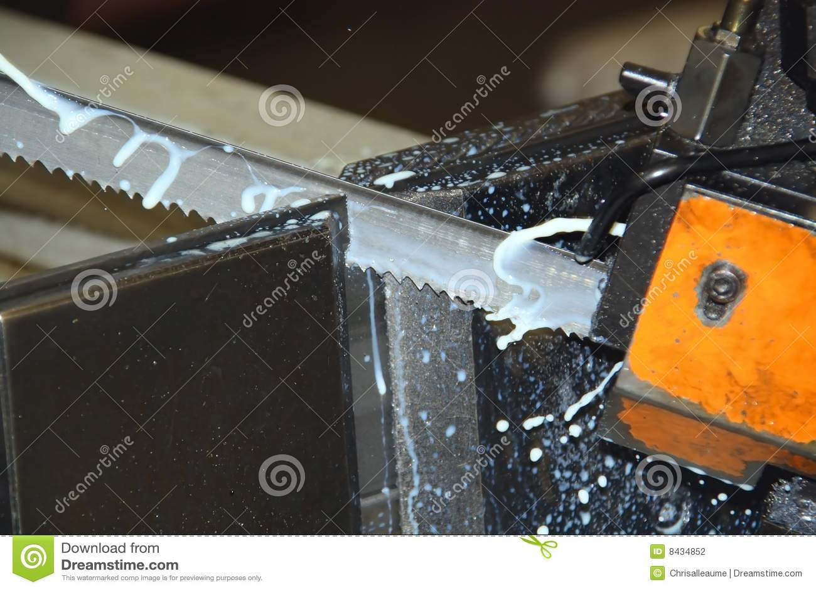 Industrial bandsaw cutting metal