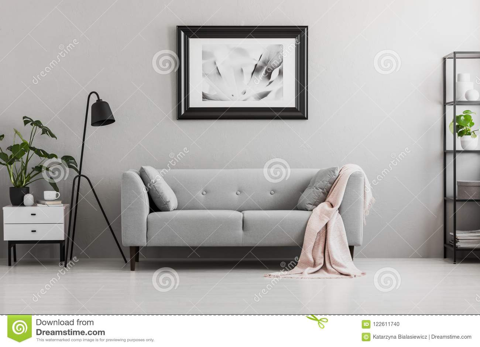 Industrial black floor lamp and a pink blanket on an - Elegant floor lamps for living room ...