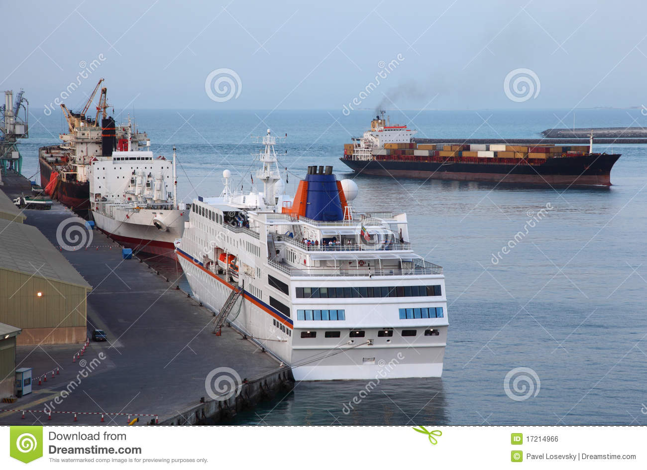 Industrial Cargo Ships And Cruise Liner At Port Royalty
