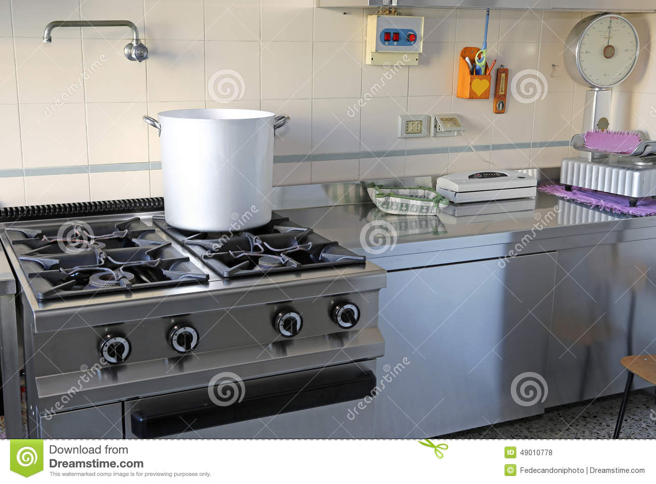 Industrial Kitchen With Gas Stove And The Giant Aluminum Pot