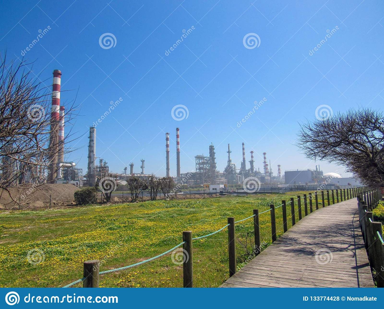 Industrial landscape with plant factory chimneys and beautiful spring nature landscape, Portugal