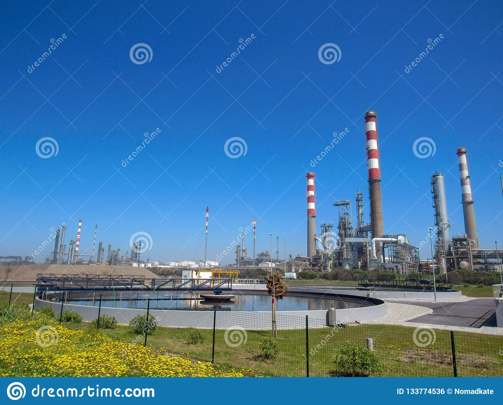 Industrial landscape with plant factory chimneys and beautiful spring nature landscape, Portugal, Europe