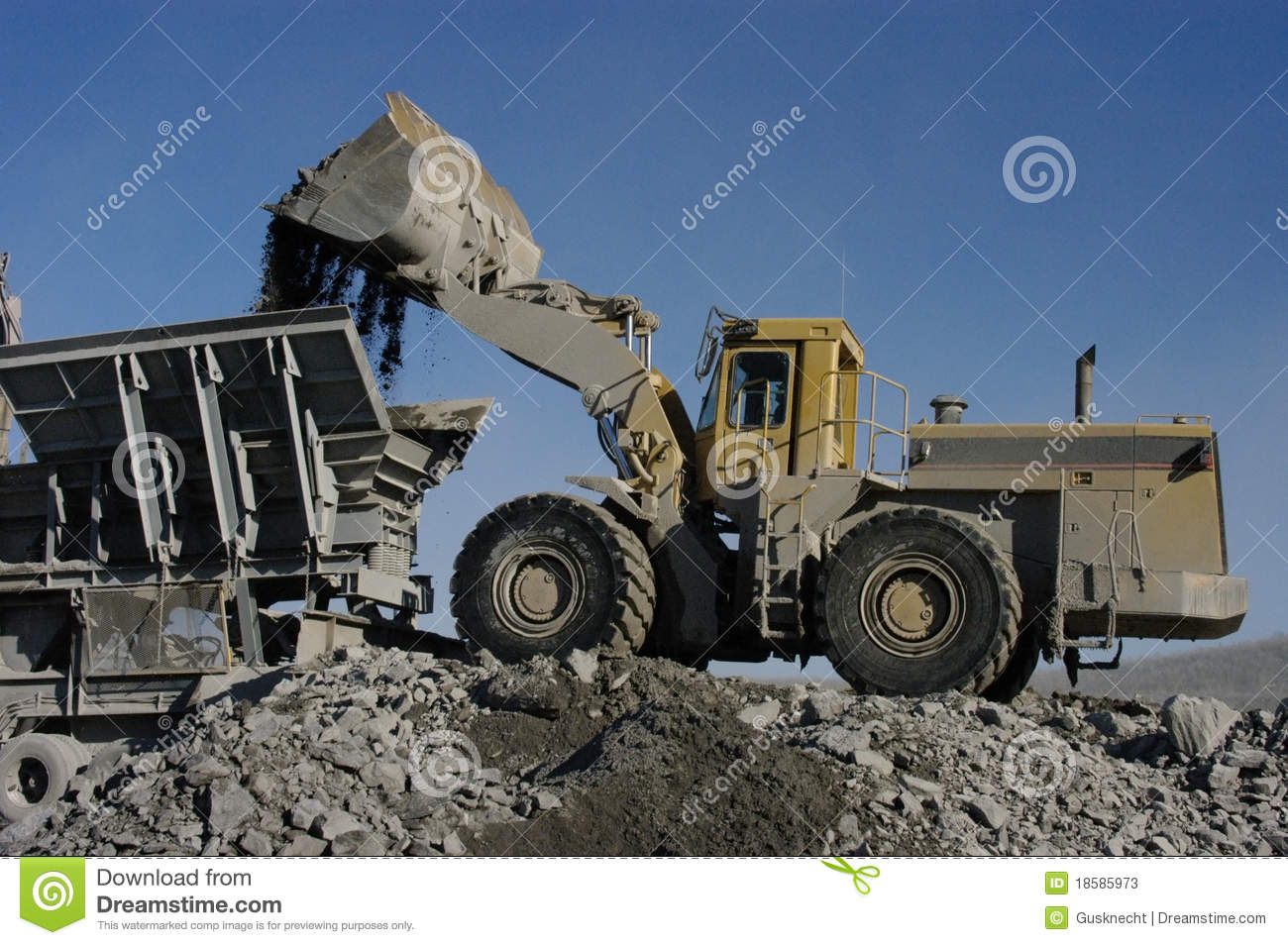 Industrial Loader Dumping Aggregates In Crusher Stock Image