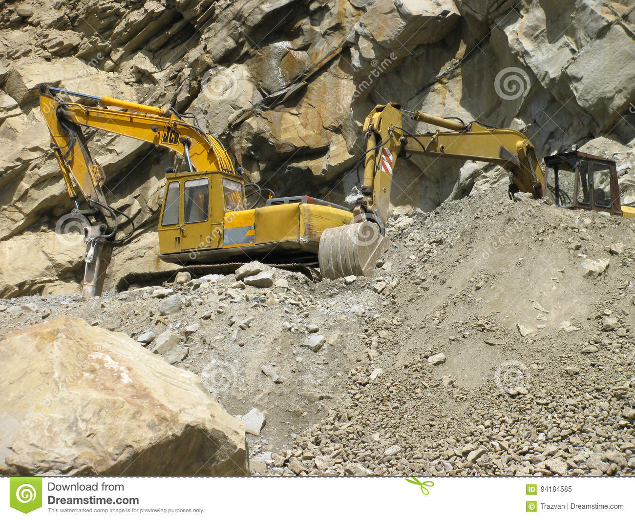 Industrial machines digging in the mountain