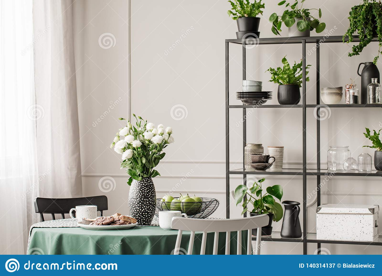Industrial Metal Shelf With Dishes And Plants In Bright ...