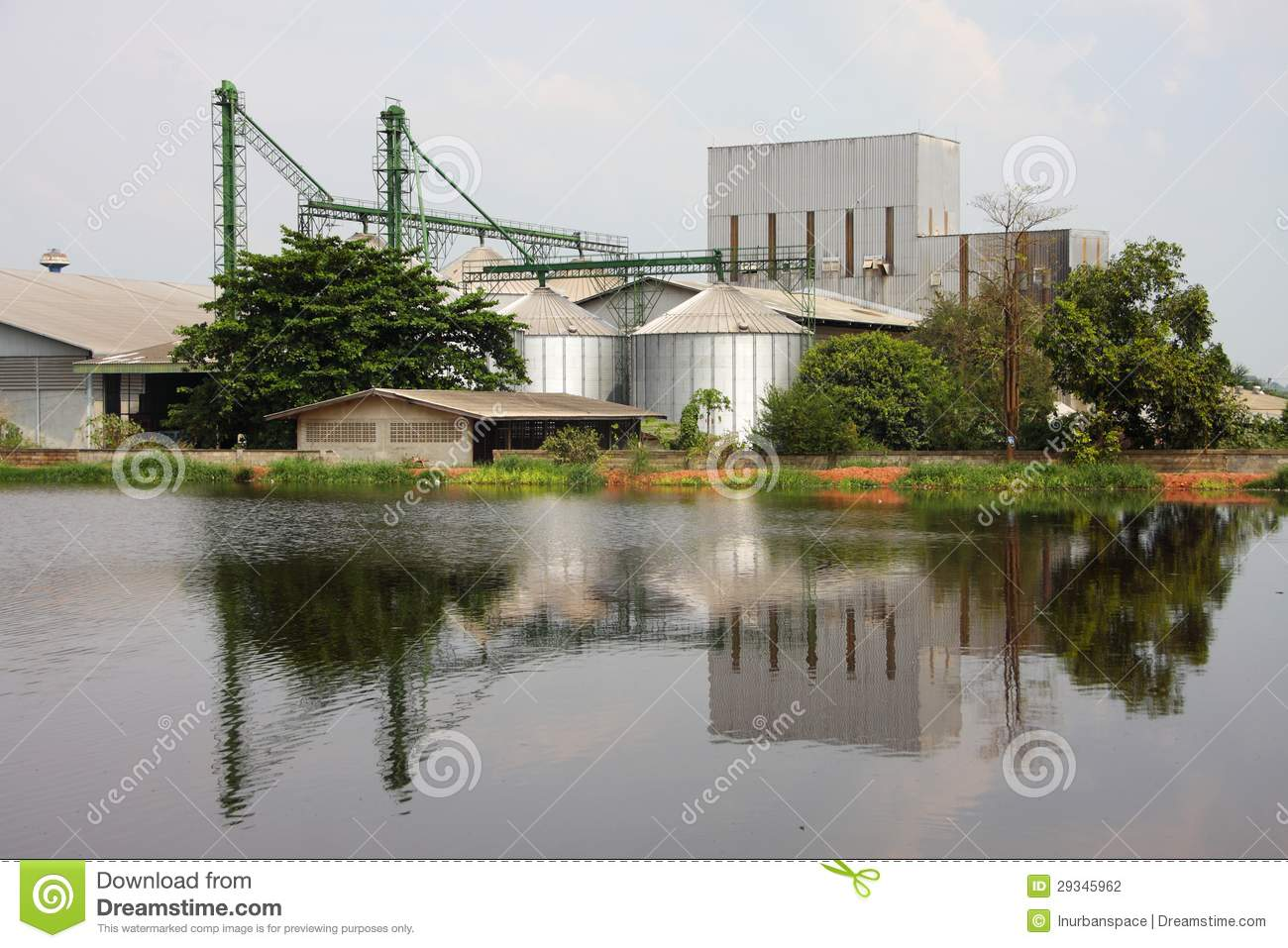 Industrial silo near pond stock photography image for Pond equipment near me