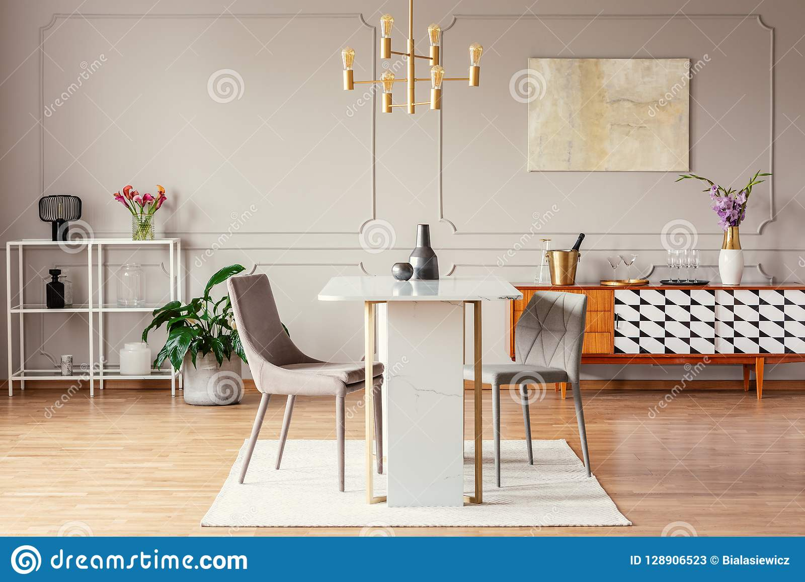 Industrial Style Golden Pendant Light Above An Exceptional Marble Table In A Trendy Dining Room Interior Stock Image Image Of Home Elegant 128906523