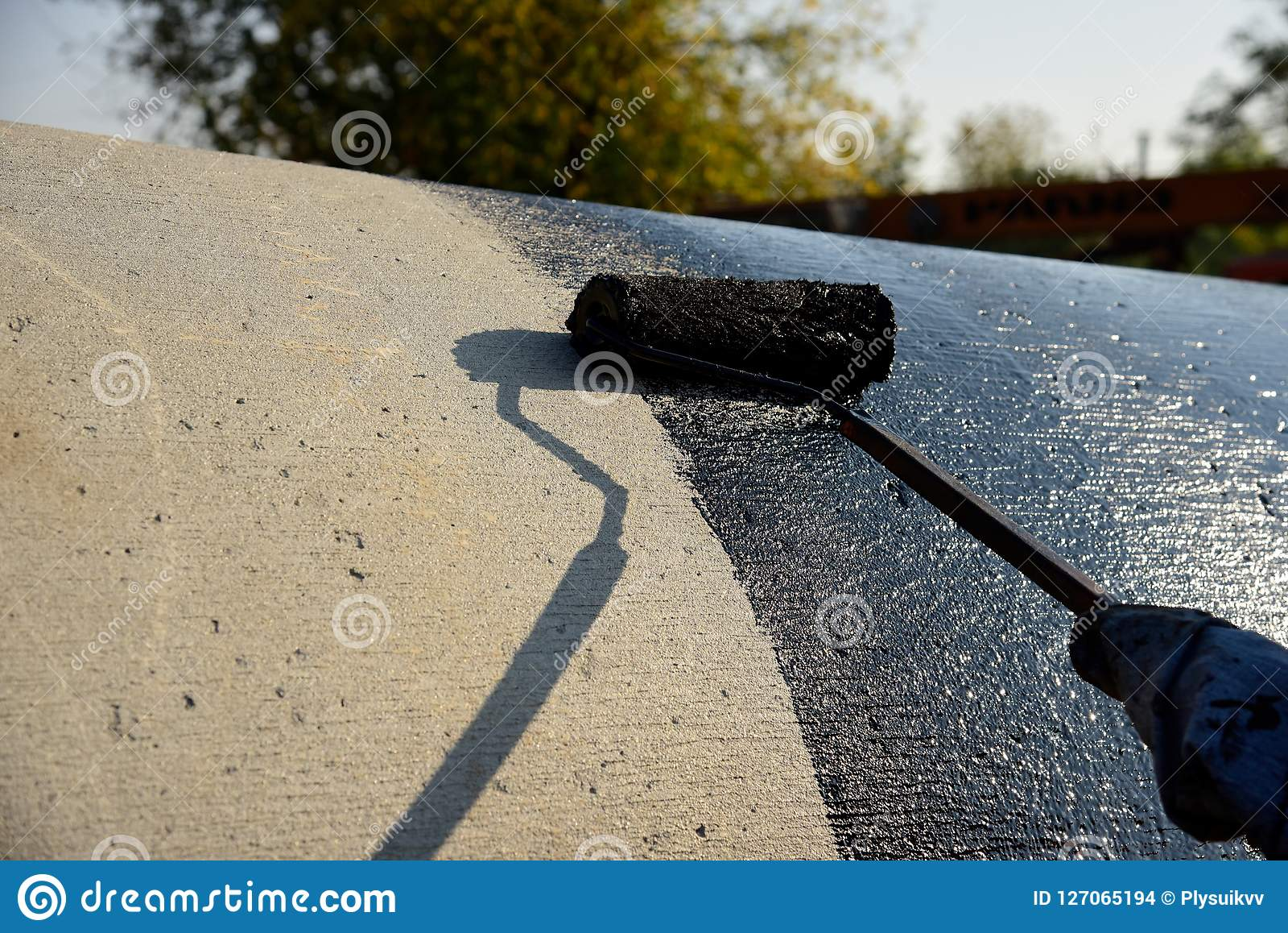 Industrial worker on construction site laying sealant