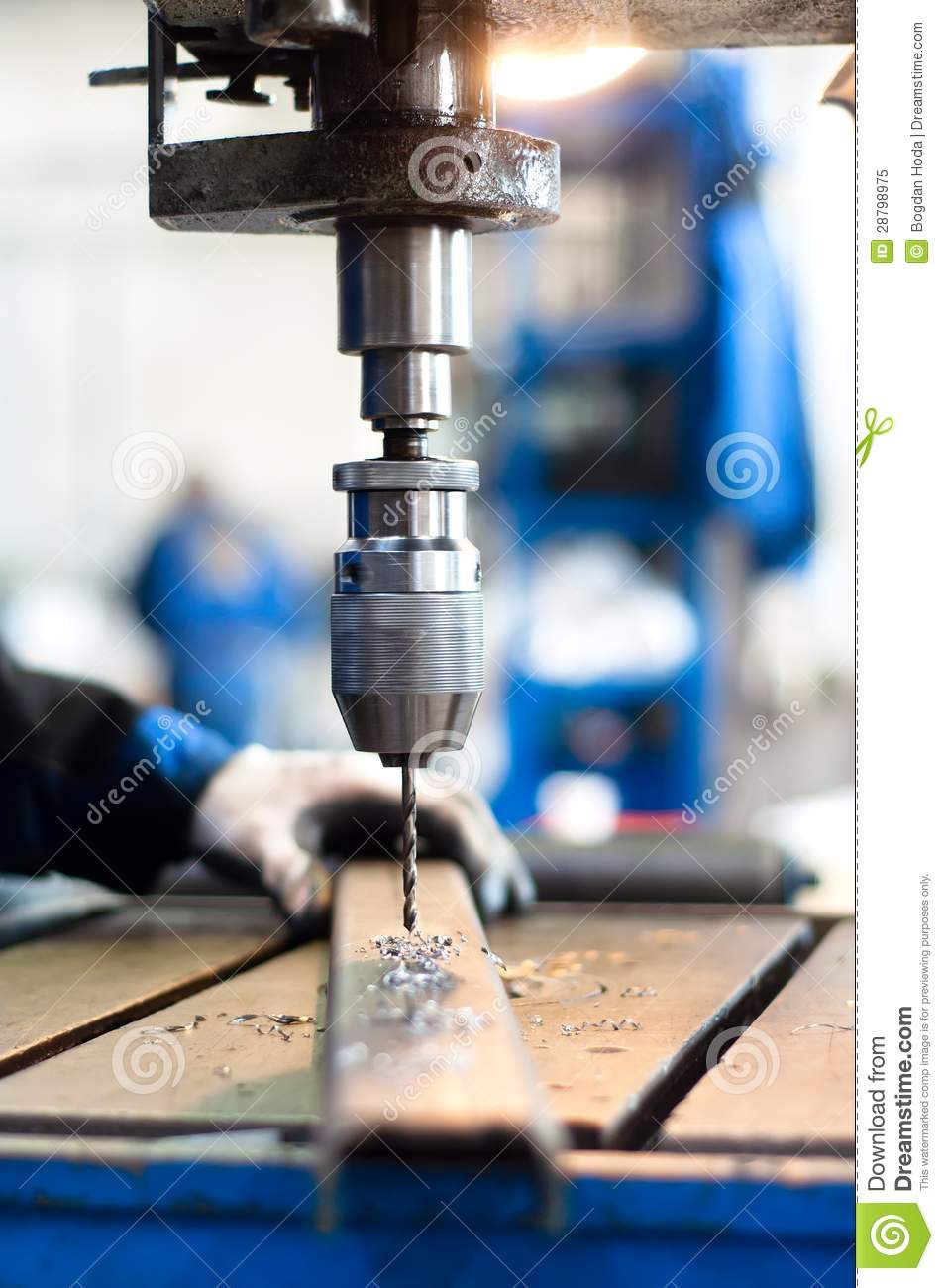Industrial worker using a mechanical drill machine