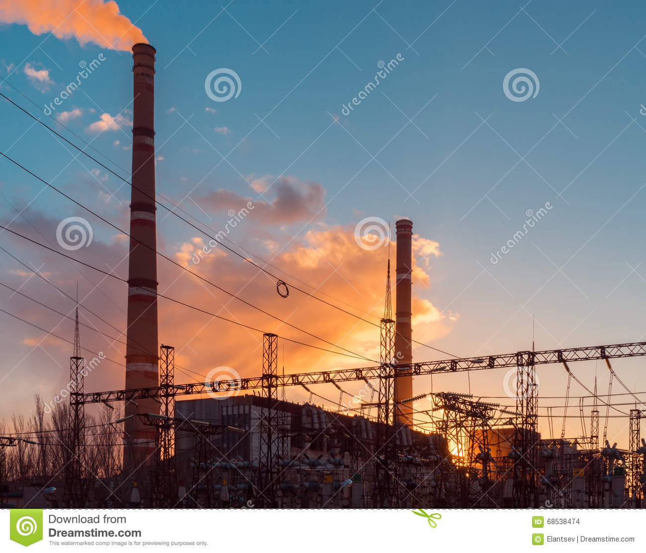 Industry electricity plant, during sunset, electric substation with power lines