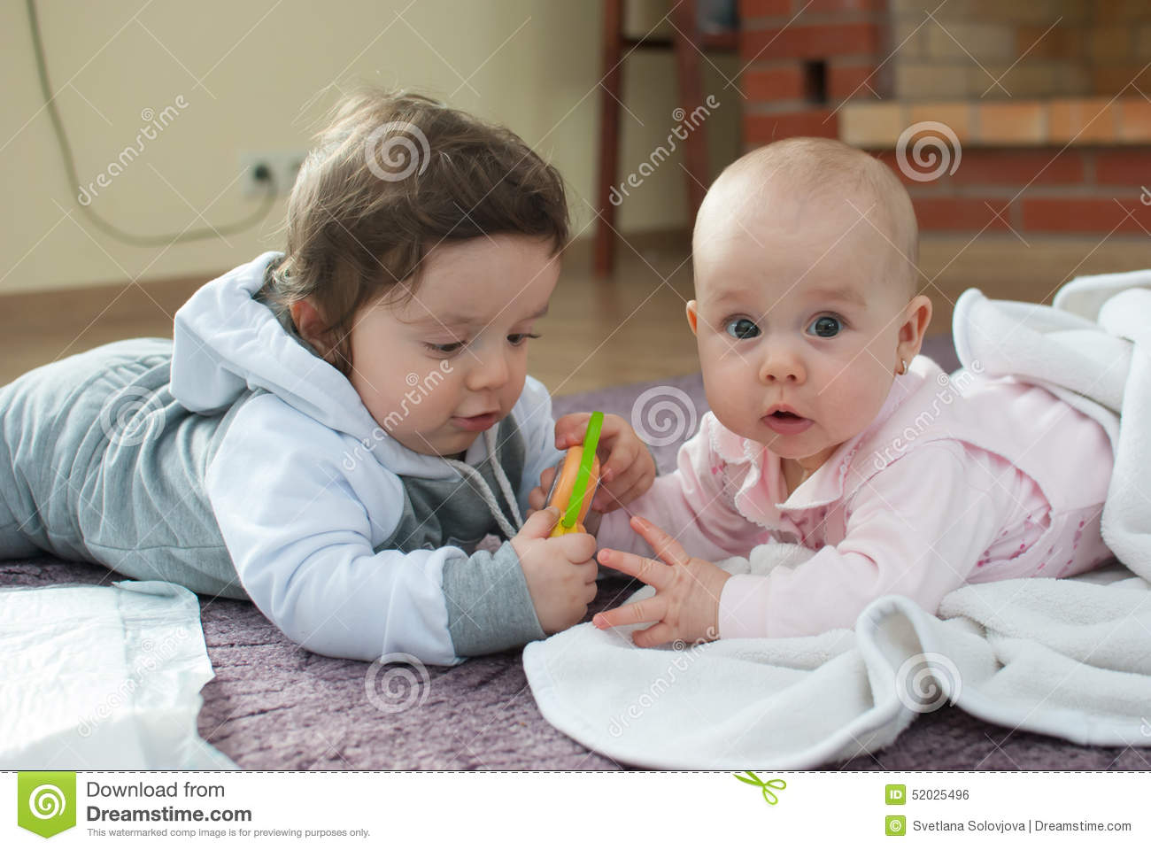 Boys Sharing Toys : Infant boy and girl on the floor stock photo image