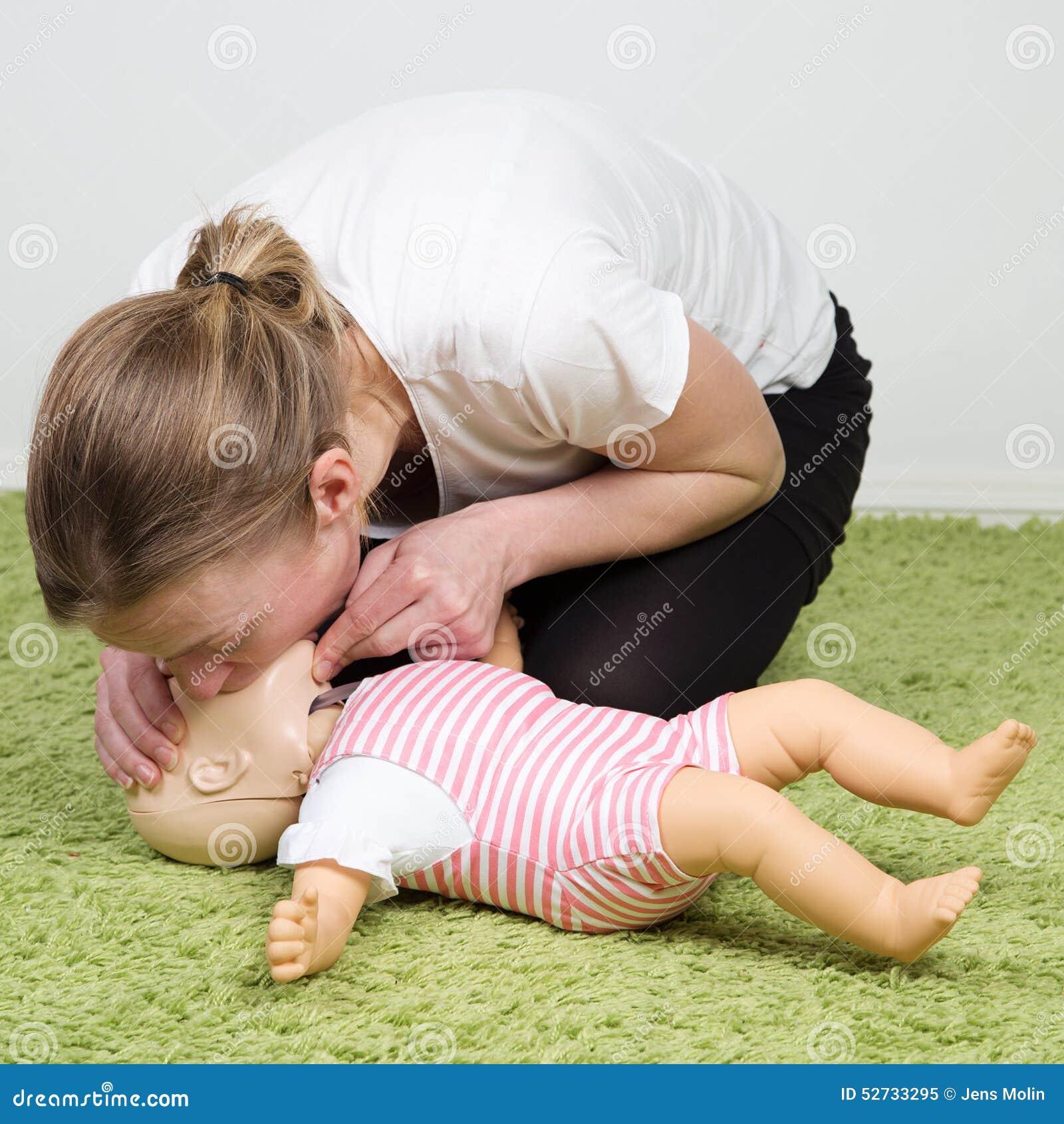 Infant CPR breathing.