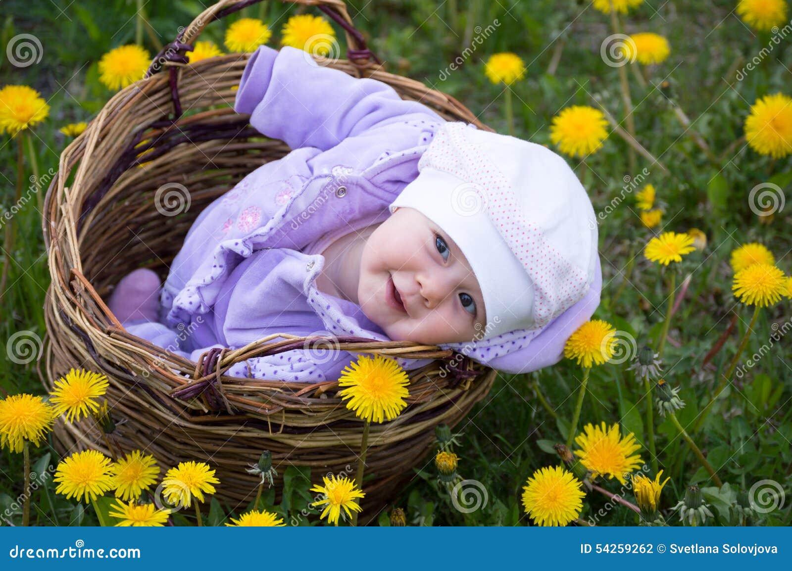 Infant girl in basket