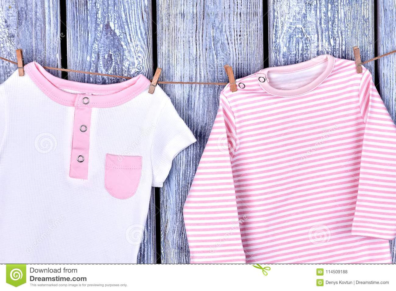 1fb12604c Infant Girl Organic Apparel On Rope. Stock Photo - Image of ...