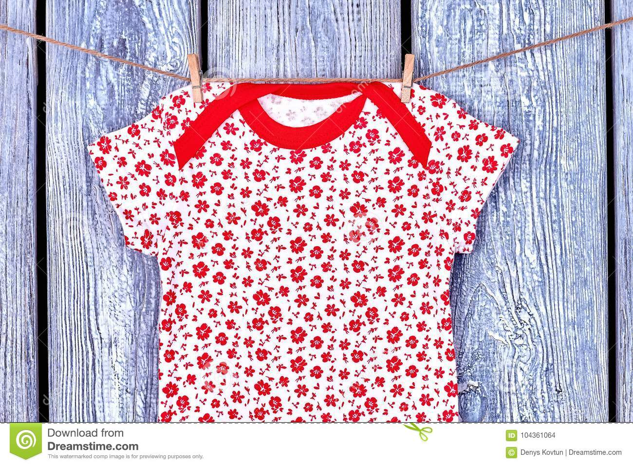 50e278ba2 Infant Girl T-shirt Hanging On Rope. Stock Photo - Image of clothes ...