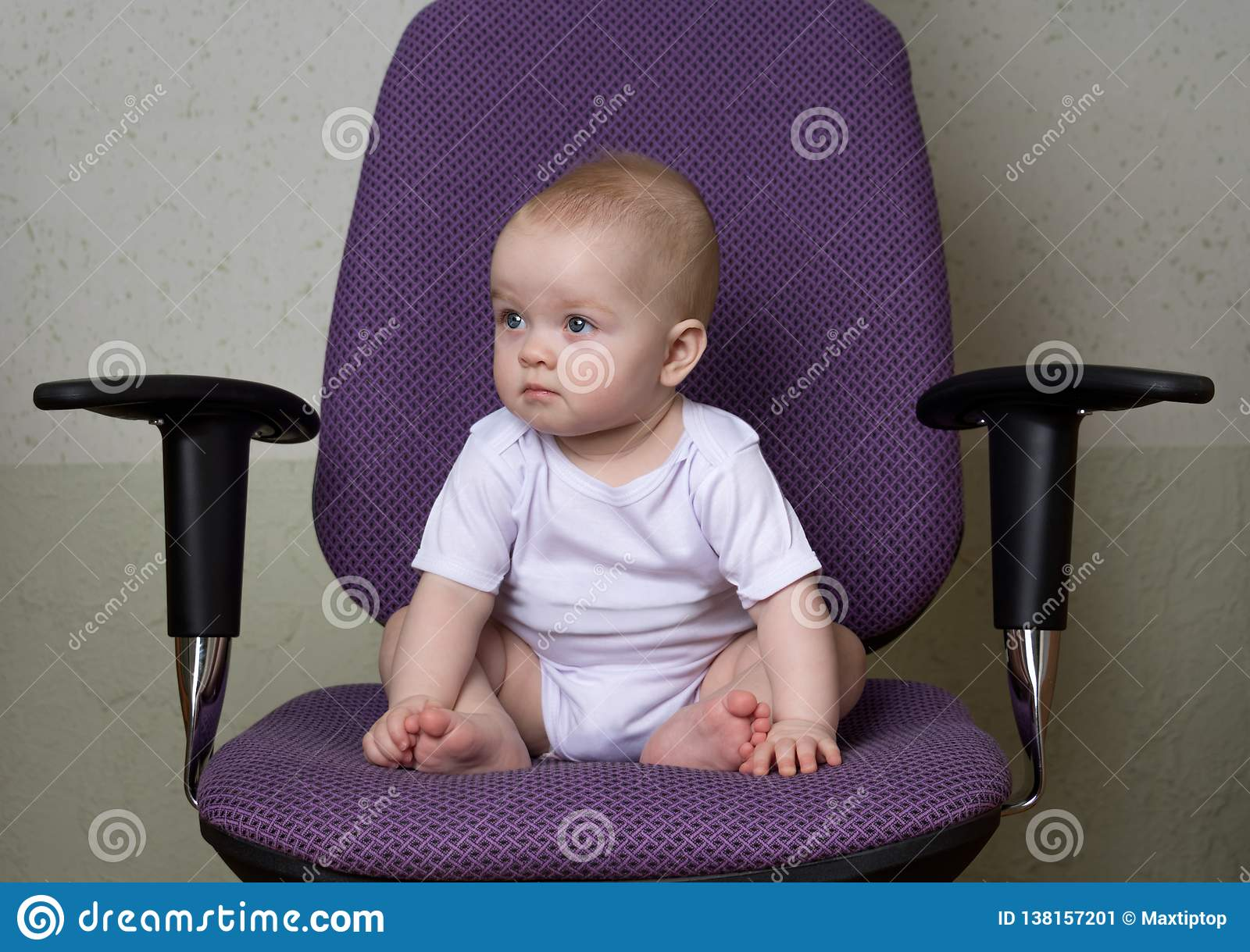 Enjoyable The Infant Sits On The Office Chair Stock Image Image Of Interior Design Ideas Apansoteloinfo