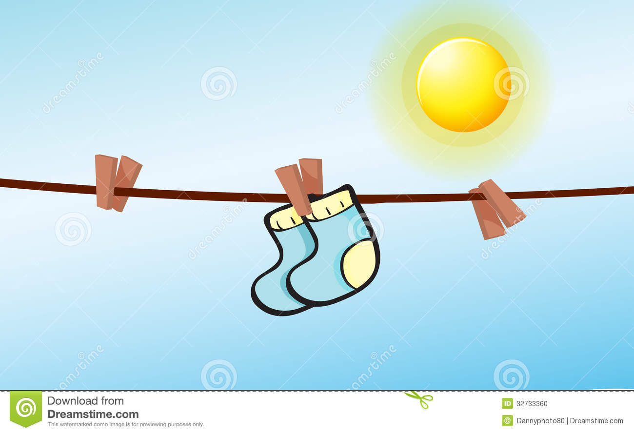 An Infant Socks Hanging With Clips Stock Photo