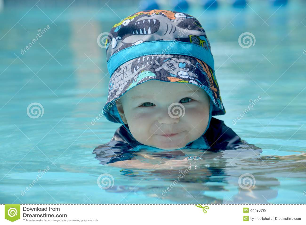 Baby Swimming with Hat stock image. Image of family f43b988eb69