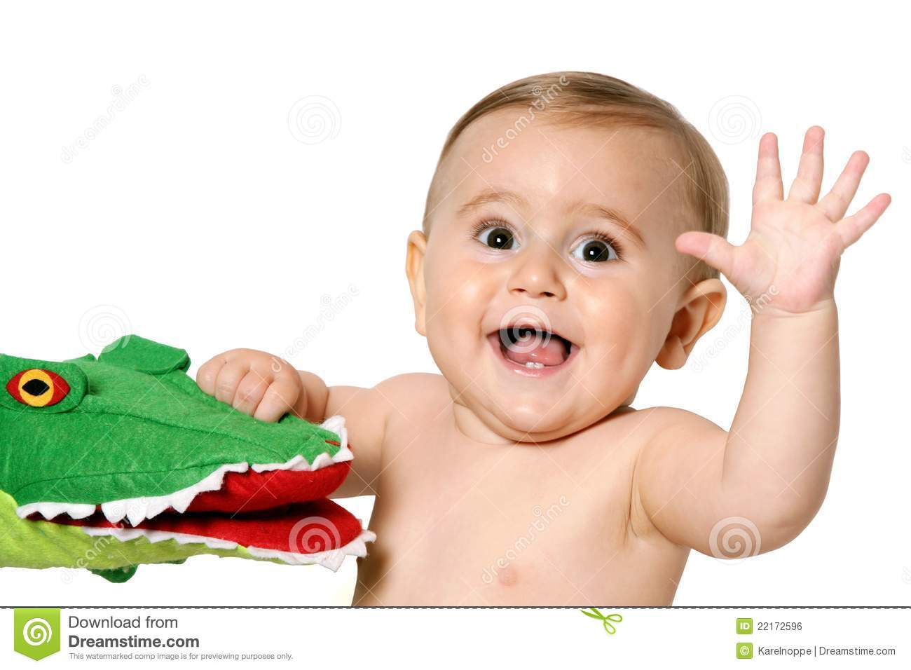 Infant With Toy Waving Hand Royalty Free Stock Image - Image: 22172596