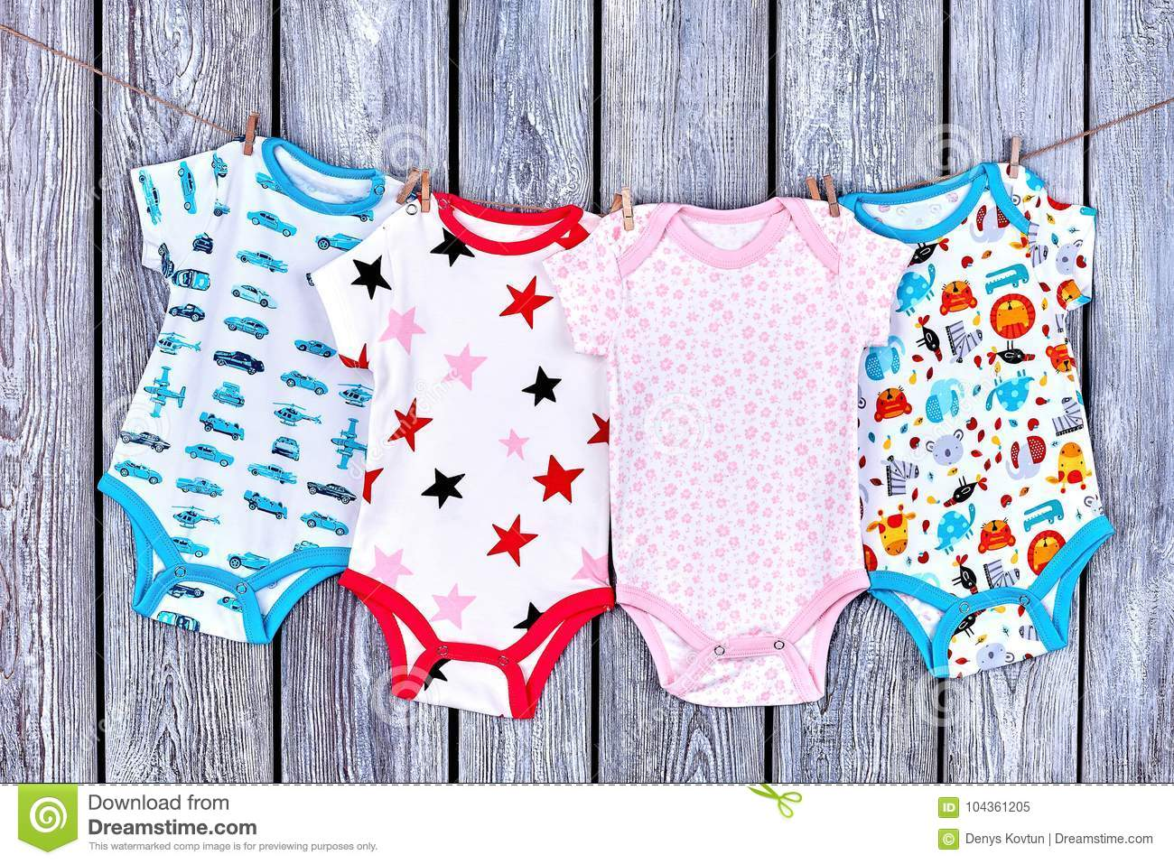 65f4101c7 Infants Clothes Hanging On Rope. Stock Image - Image of dainty ...