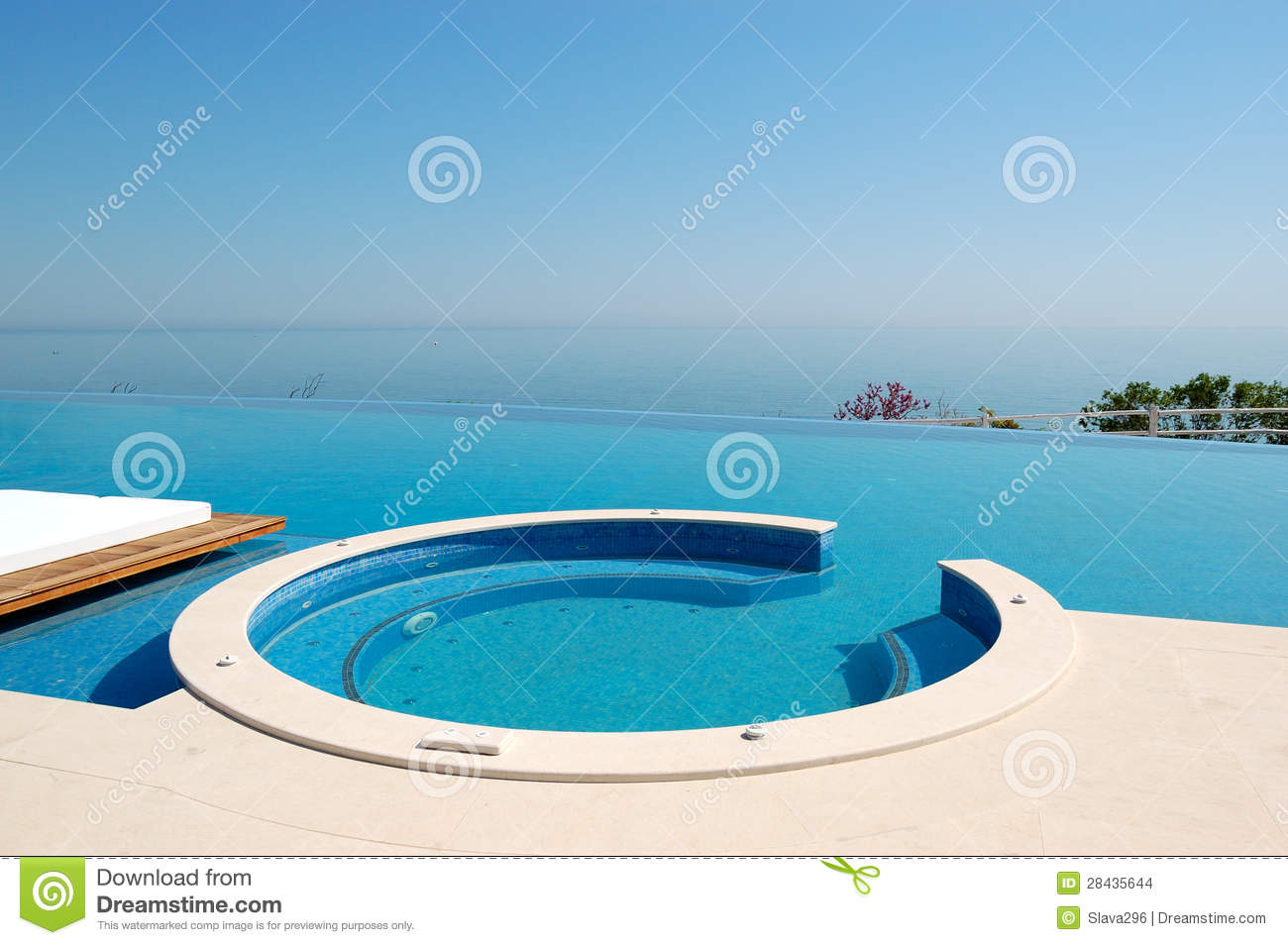 infinity swimming pool with jacuzzi by beach stock images. Black Bedroom Furniture Sets. Home Design Ideas