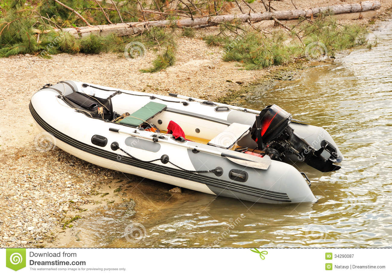 Inflatable Boat With A Motor Royalty Free Stock
