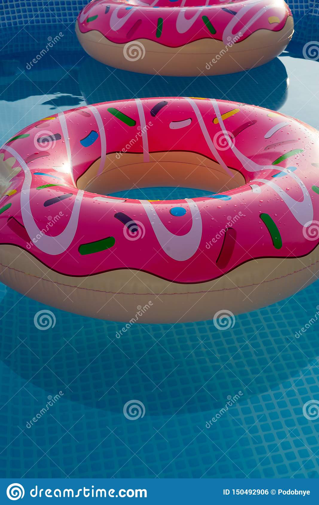 Inflatable rings in house swimming pool for children