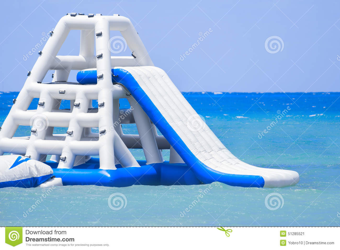 http://thumbs.dreamstime.com/z/inflatable-slide-caribbean-island-resort-large-ocean-beautiful-blue-water-background-51285521.jpg