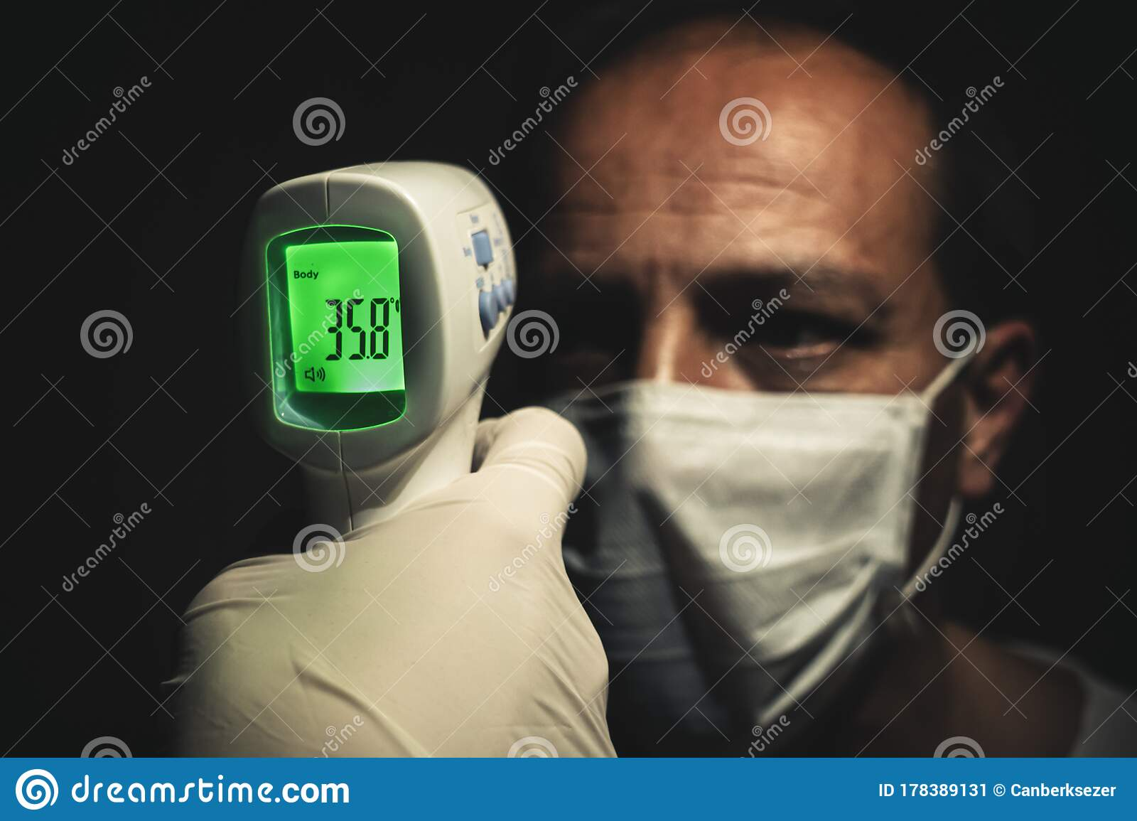 Infrared Thermometer Measuring A Healthy Senior Man`s Normal Body  Temperature Stock Image - Image of infection, illness: 178389131