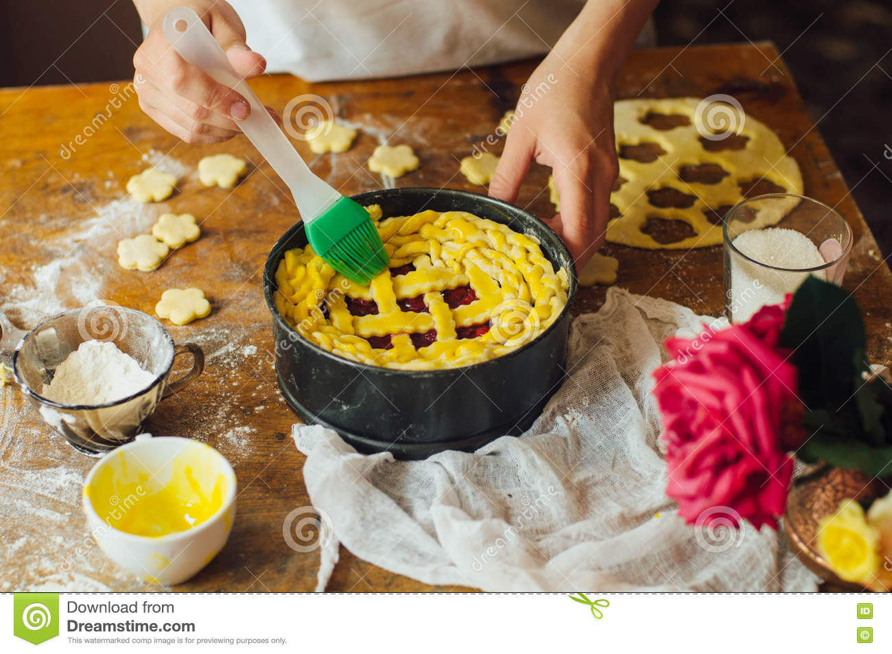 baking cake stuffed with fresh cherry pie. Female preparing cherry pie ...