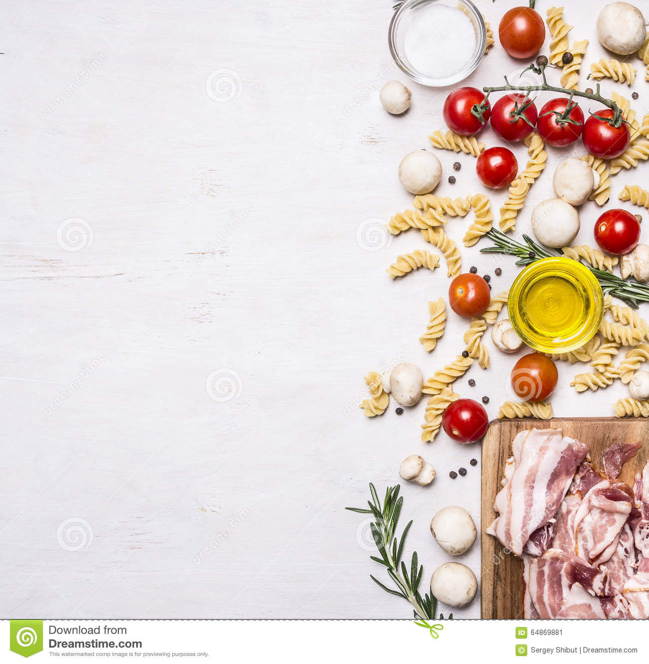 Ingredients for cooking fusilli pasta with bacon vegetables, spices and herbs border, place text on wooden rustic background