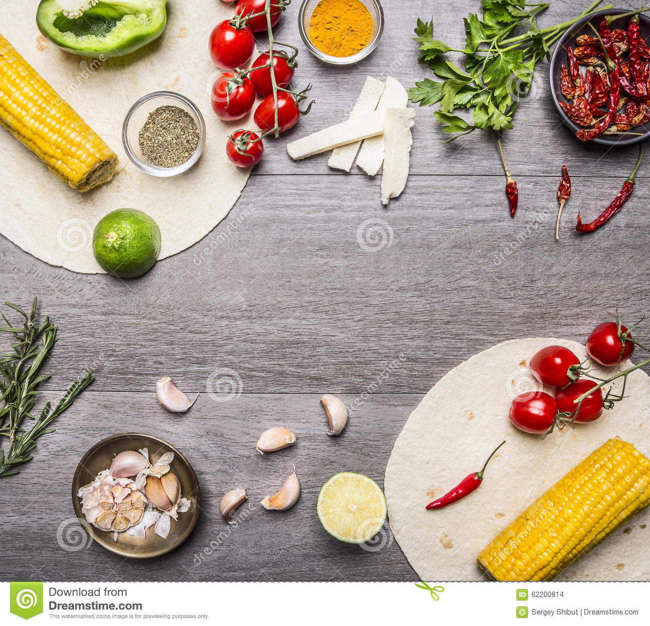 Ingredients for cooking vegetarian burritos lined frame, with tomatoes, pepper, spicy chili, corn, cheese and garlic border with s