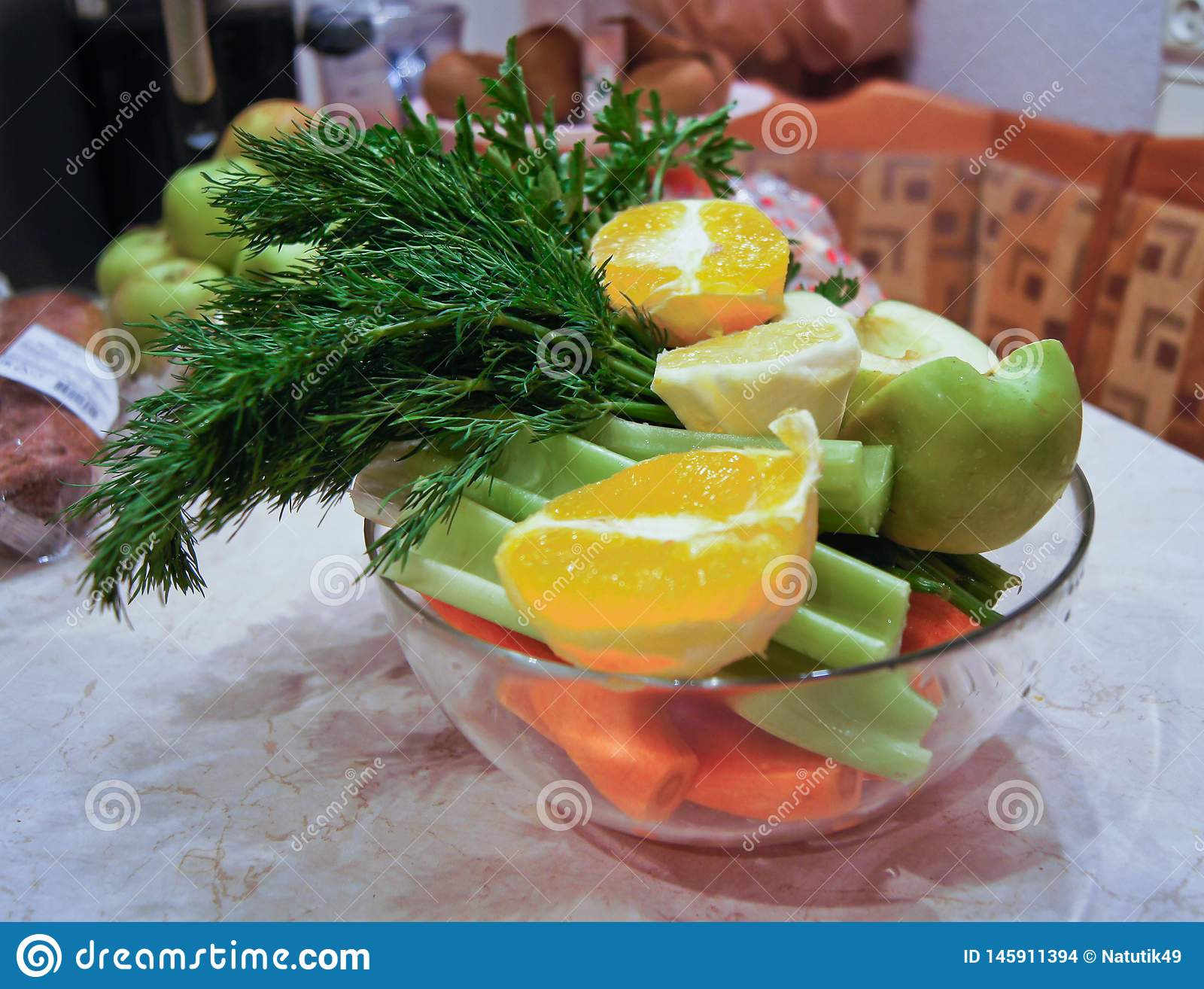 Ingredients for diet salad, apples and celery and fresh carrots