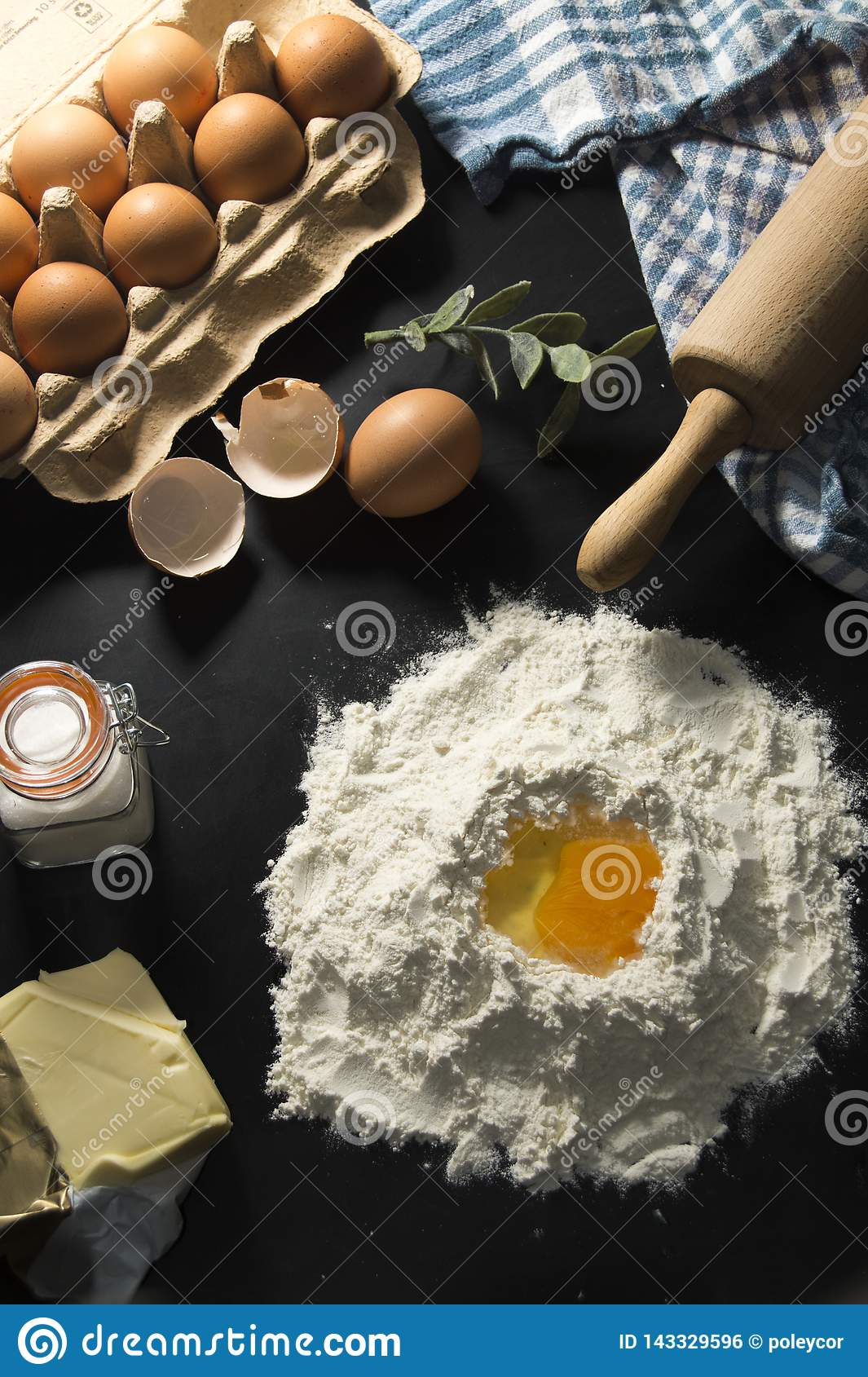 Ingredients of making a cake or pie, with eggs, sugar and butter.