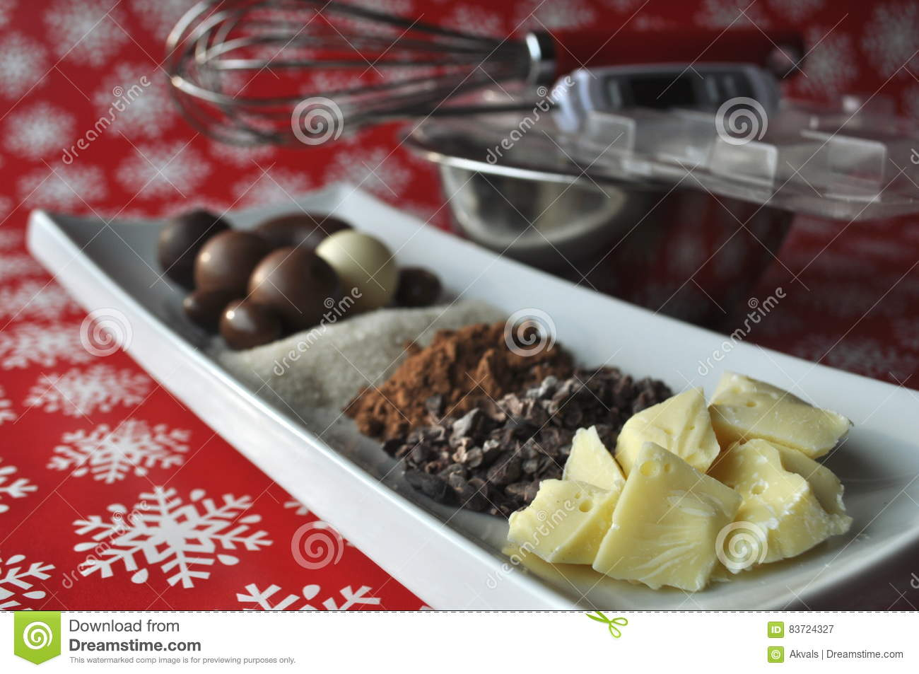 Ingredients And Tools For Making Chocolates On Winter Background With Snow Flakes Stock Photo