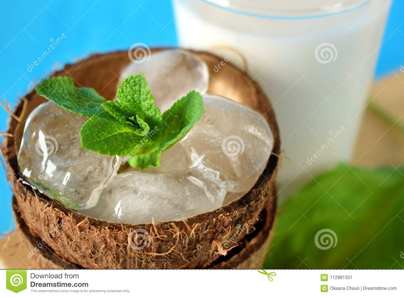 Ingredients for a tropical cocktail on blue background