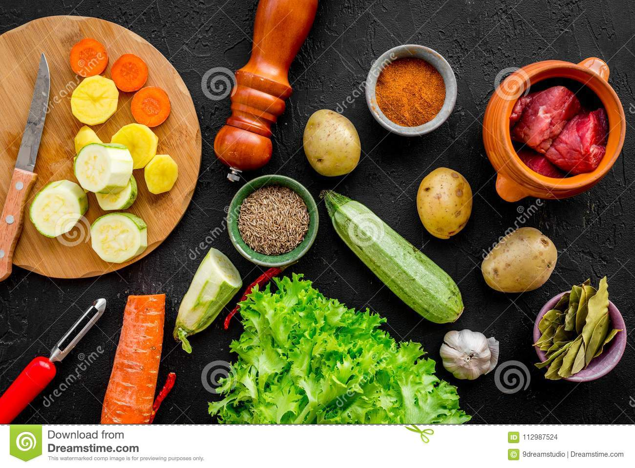 Ingredients for vegetable ragout cooking on stone table background top view