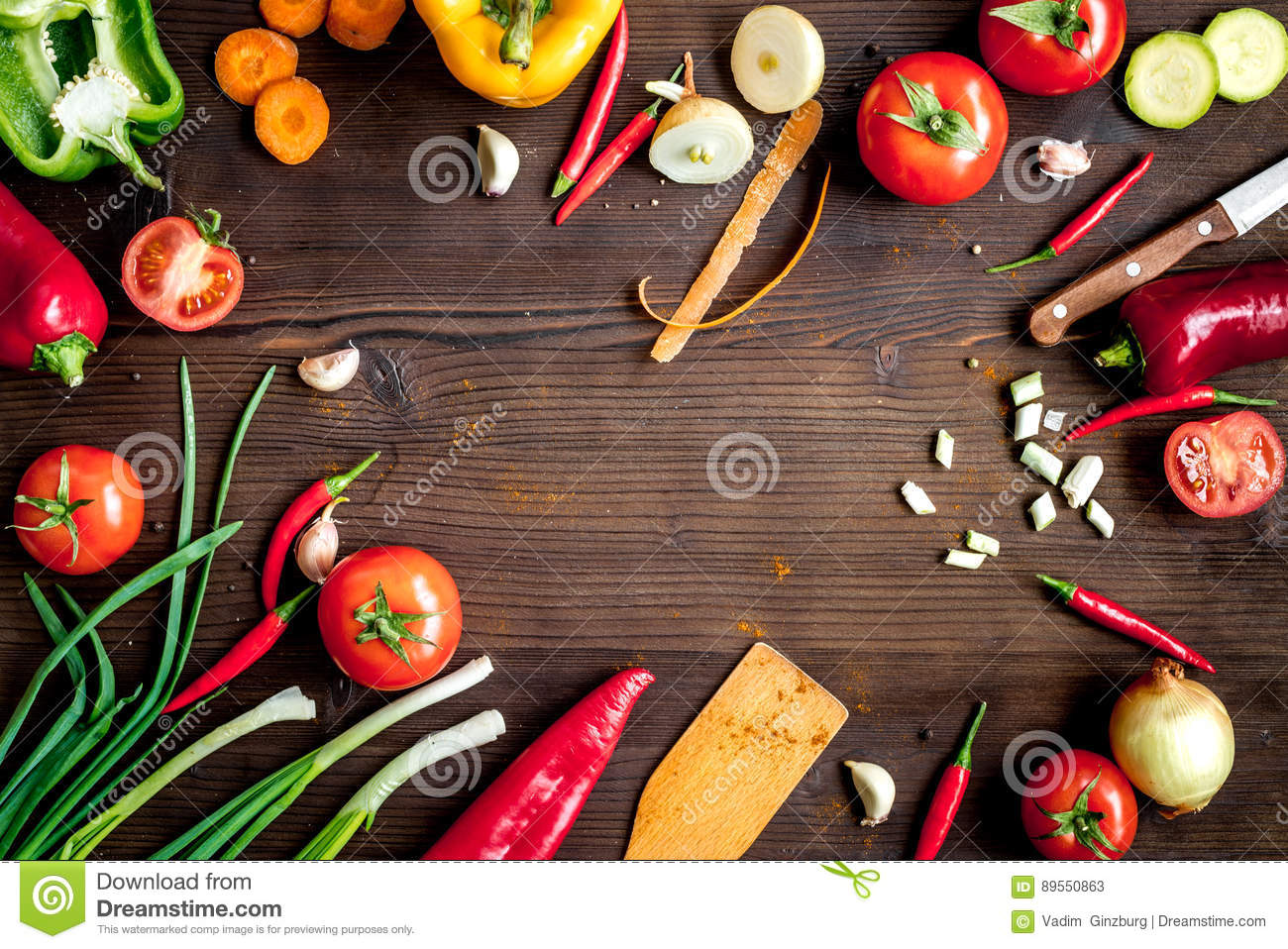 Ingredients for vegetable ragout on wooden background top view