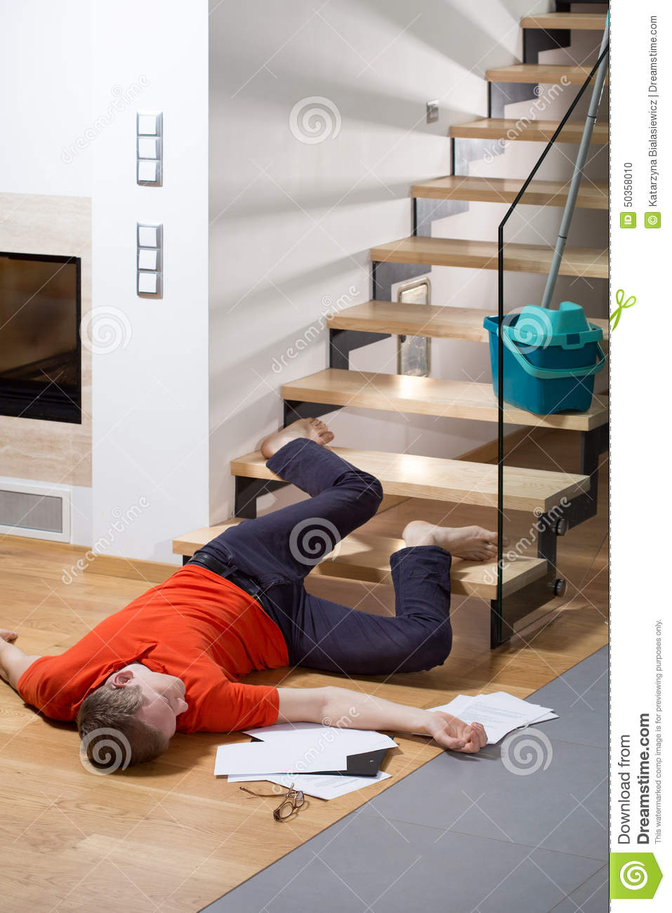Injured man lying on the floor stock photo image 50358010 for Down to the floor
