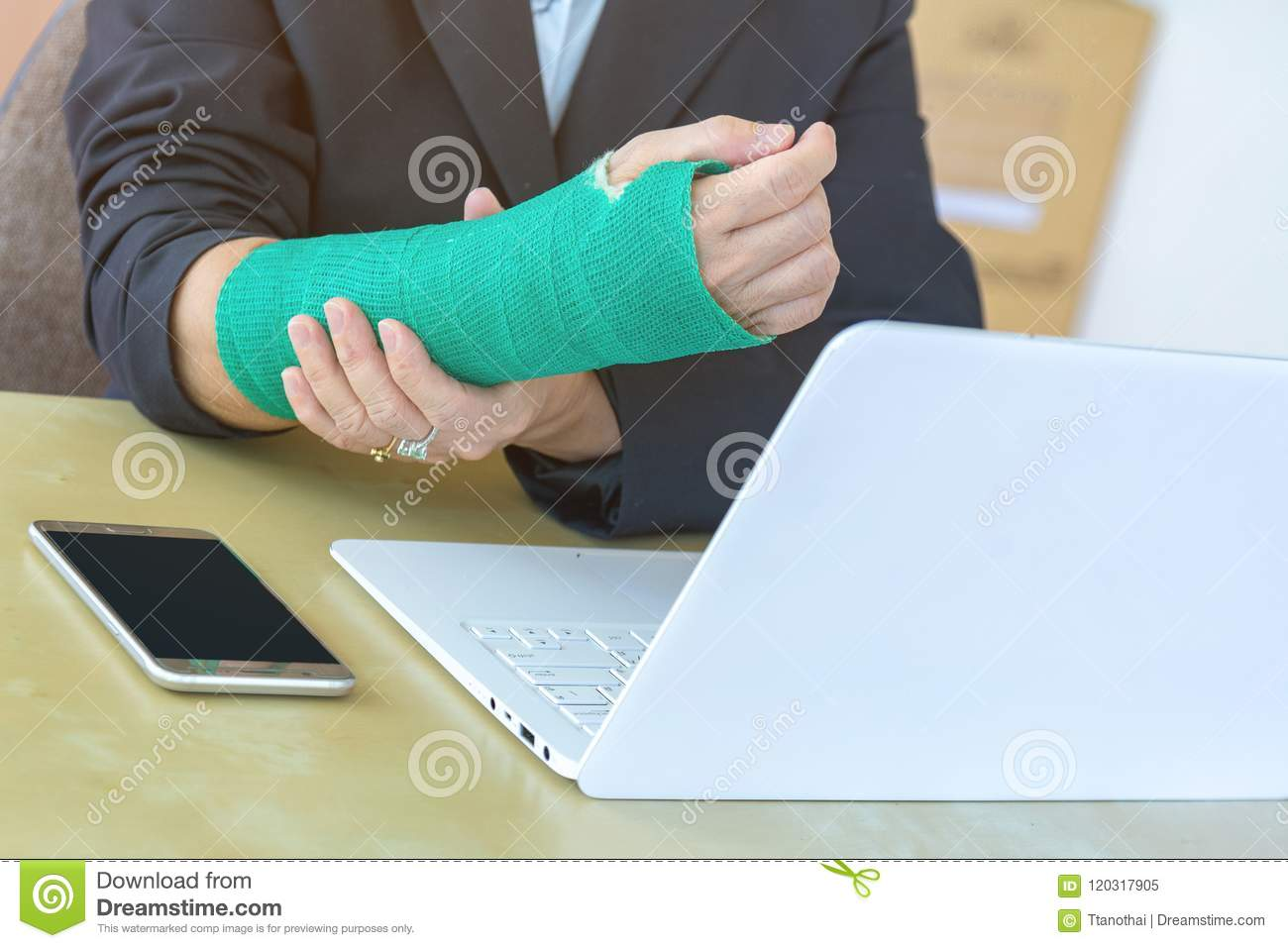 Injured Woman With Broken Hand Sitting And Holding Green