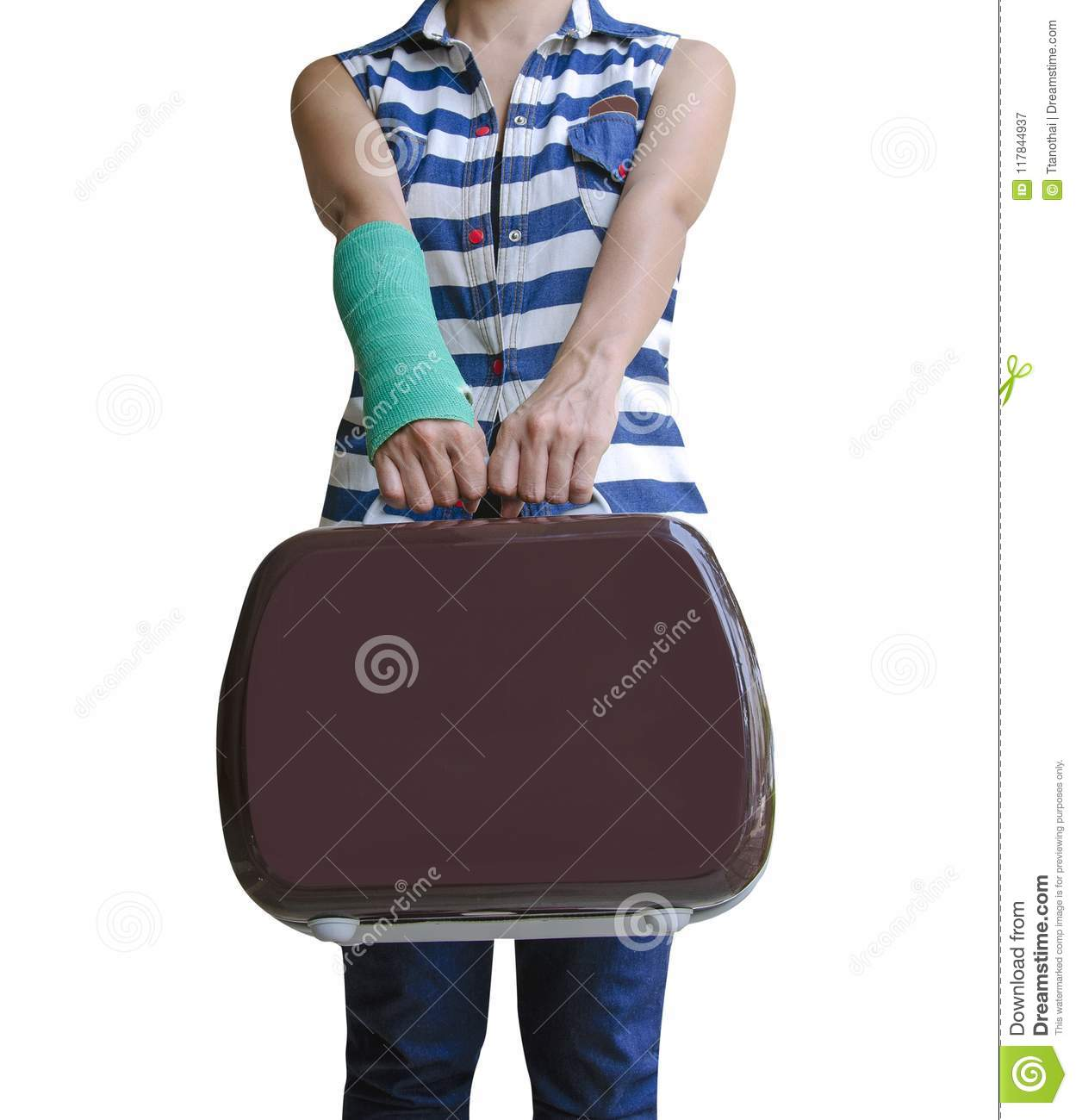 injured woman traveler broken arm in green cast standing and holding suitcase isolated on white background, clipping path included