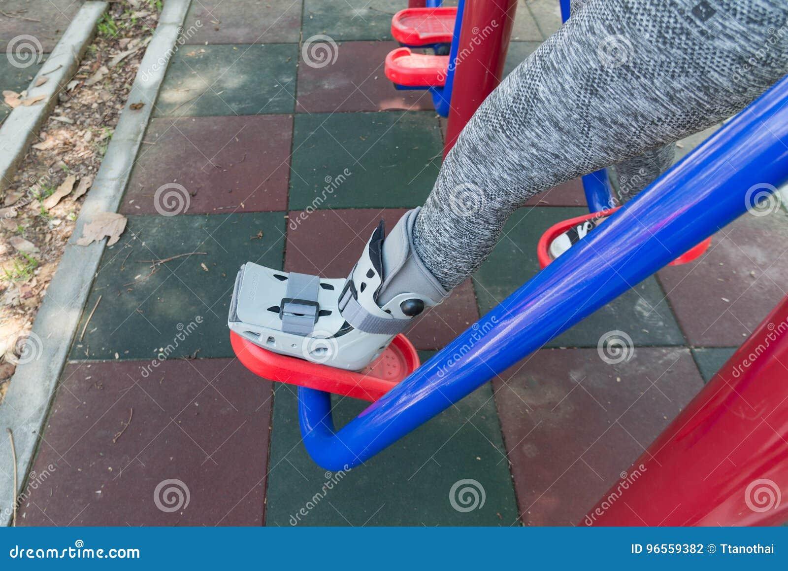 Injured Woman Wearing Sportswear Broken Ankle Wearing Ankle