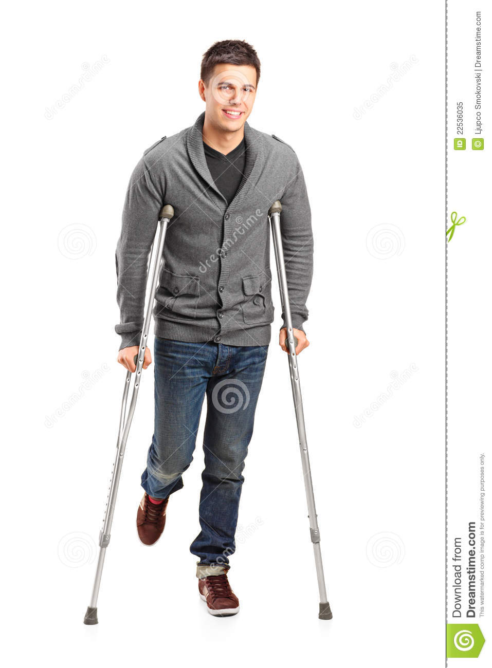 Full length portrait of an injured young man on crutches on white ...